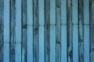 Wooden fence with metal bars