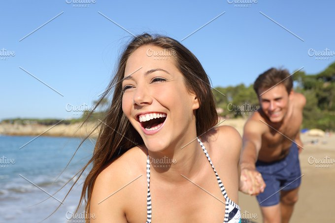 Couple running and playing on the beach.jpg - People