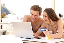 Couple buying online on holidays.jpg