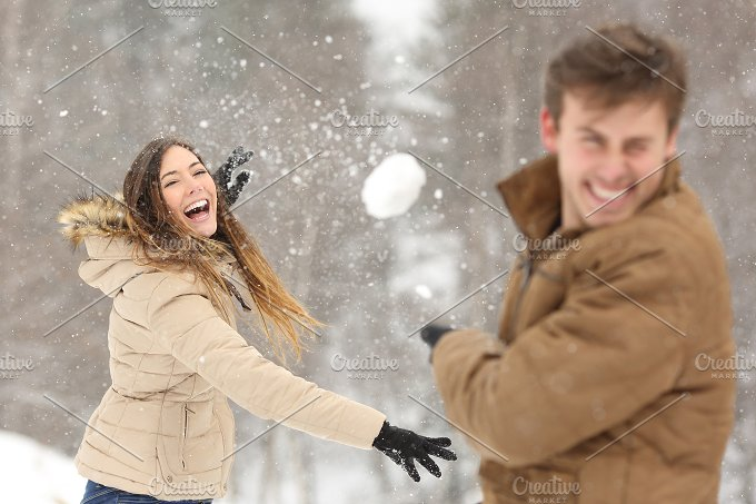 Couple playing with snow and girlfriend throwing a ball.jpg - People