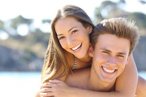 Couple with perfect smile posing on the beach.jpg