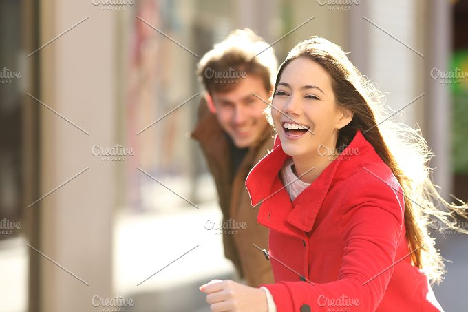 Happy couple running in the street.jpg - People