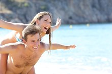 Happy couple playing on the beach.jpg