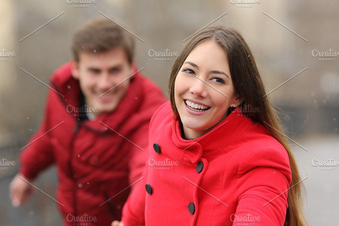 Happy couple running towards camera in winter.jpg - People