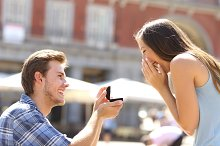 Proposal in the street man asking marry to his girlfriend.jpg