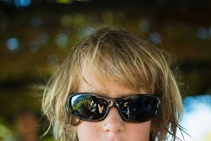 Blond boy with sunglasses