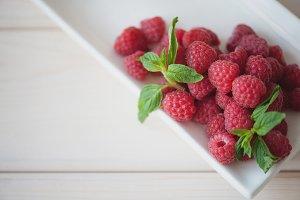 Ripe raspberry with mint