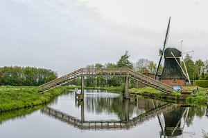 Dutch wooden bridge and windmill