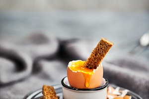 Soft boiled egg with rye toasts for
