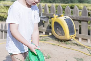 young gardener watering the garden