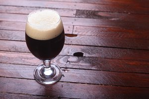 Dark beer on wood