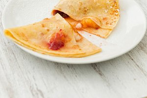 Crepes with peach fruit and cream