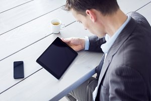 Businessman with tablet and mobile