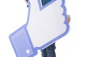 Boy holding Facebook thumbs up