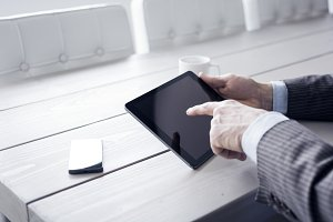 Businessman using iPad tablet PC