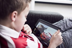 boy watching movie on a tablet pc