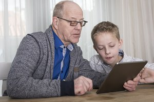 grandpa and grandson on tablet pc