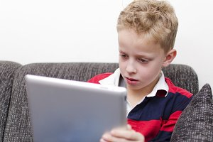 boy using tablet pc