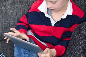 boy playing with tablet pc