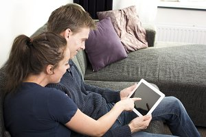 couple watching tablet pc