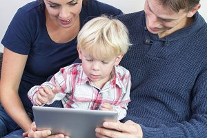 Happy family on tablet pc