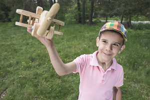 Child play with a wooden plane