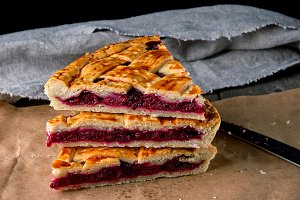 baked pieces of cake with cherries