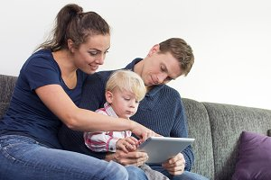 family on tablet pc