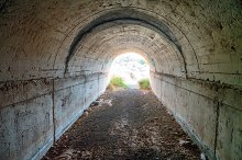 Abandoned tunnel with light at end by  in Architecture