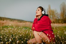 Girl listening to music with headpho by  in People