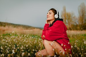 Girl listening to music with headpho