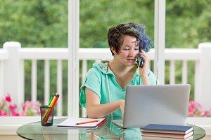 Teen chatting while doing homework