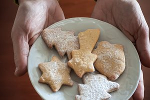 Woman offering Christmas cookies