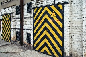 old door with yellow and black stripe