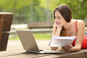 Student girl studying with a laptop in an university campus.jpg