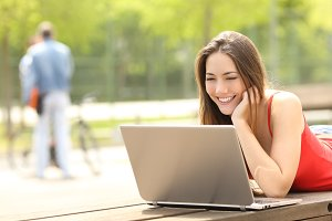 Teenager student girl using a laptop in a campus or park.jpg