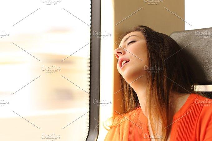 Traveler sleeping in a train travel.jpg - Transportation