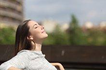 Urban woman breathing deep fresh air.jpg
