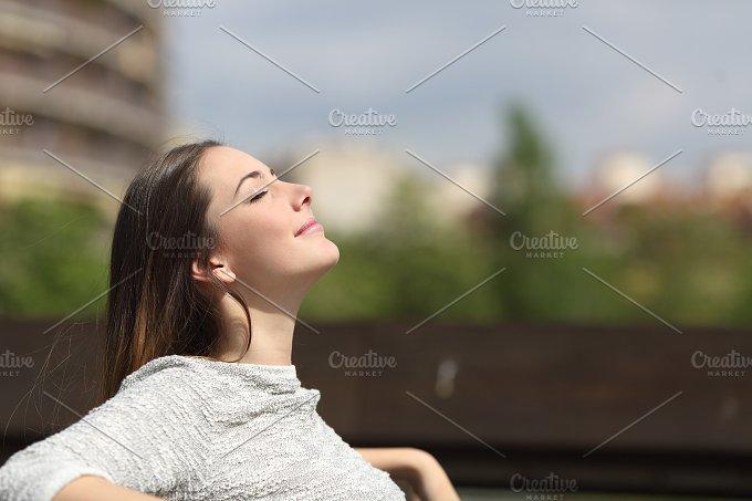 Urban woman breathing deep fresh air.jpg - Health