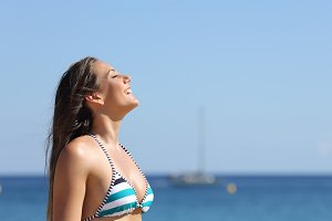 Woman breathing in summer vacations on the beach.jpg