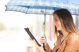Woman reading ebook or tablet under the rain.jpg
