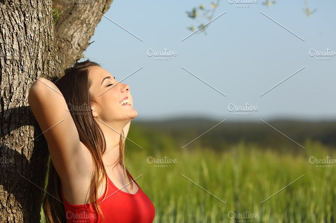 Woman resting and relaxed in a meadow.jpg - Health
