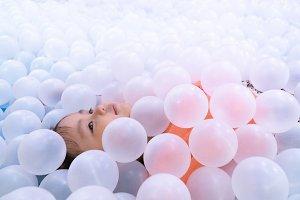 Little asian girl sleep on balls.