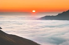 Sunrise over mountains clouds aerial by  in Nature