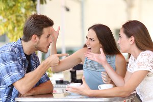 Angry friends arguing in a coffee shop.jpg