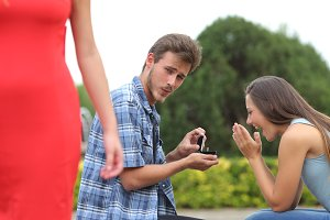 Cheater man cheating during a marriage proposal.jpg