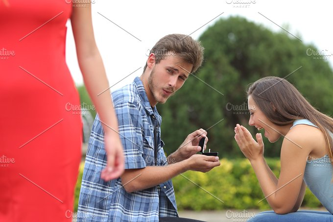 Cheater man cheating during a marriage proposal.jpg - People