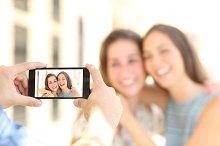 Friends taking photo with a smart phone.jpg