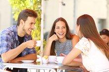 Friends talking in a coffee shop terrace.jpg