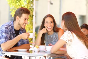 Friends talking in a coffee shop terrace.jpg